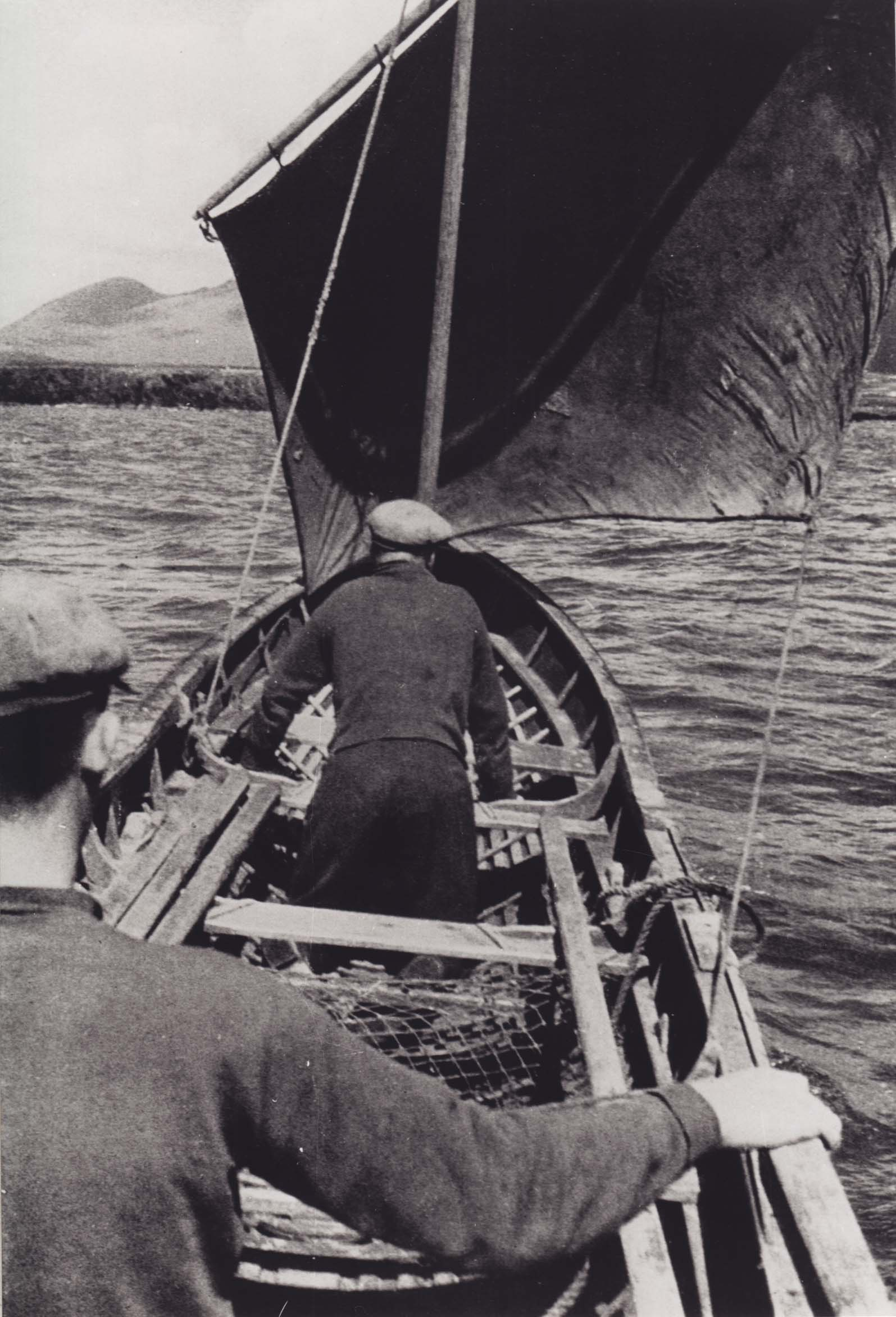 A naomhóg under sail. A sail was hoisted on the naomhógs during long journeys with favourable wind. Taken by Tomás Ó Muircheartaigh. Courtesy National Folklore Collection, UCD.