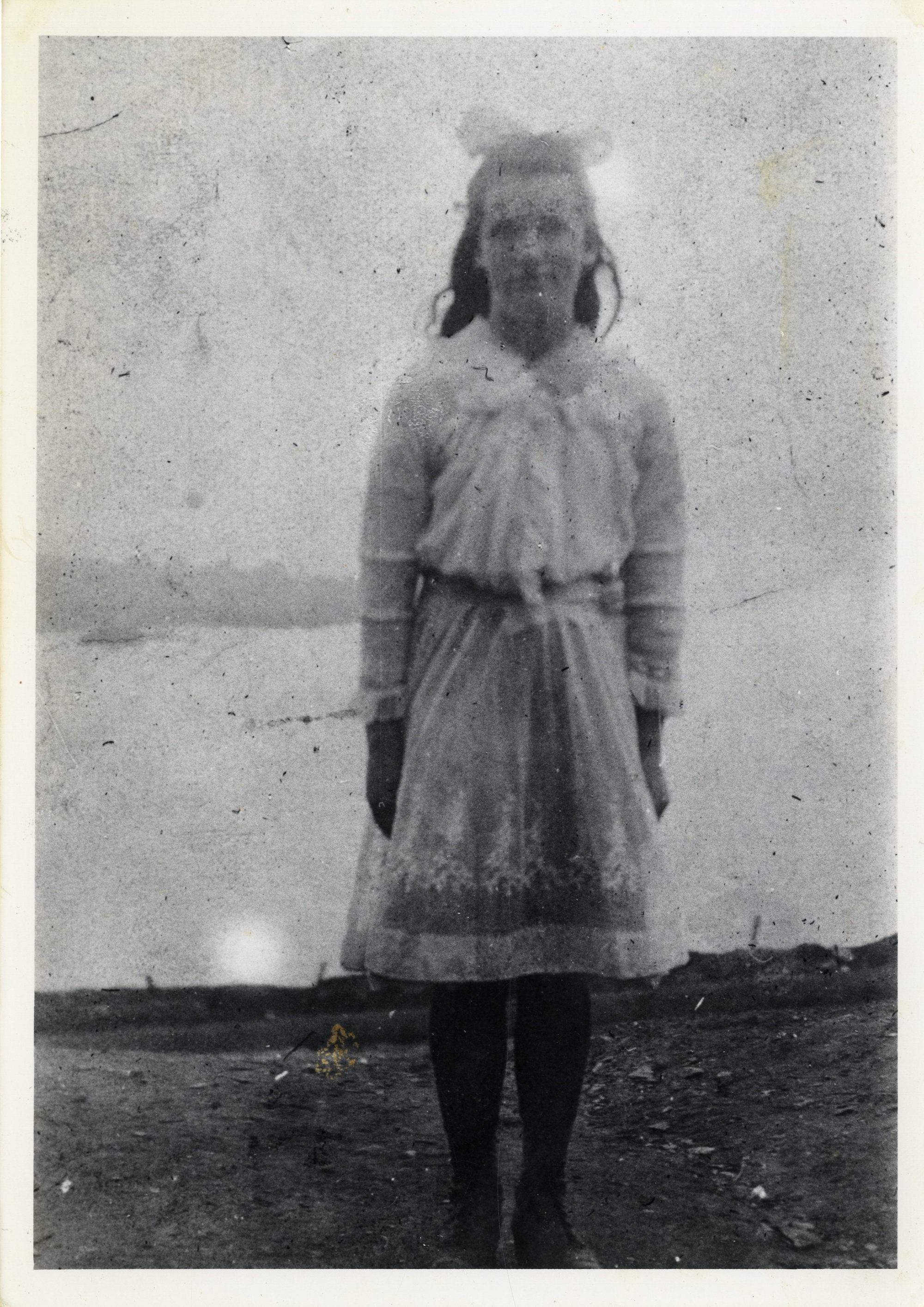 Eilís Buffer Keane on her Confirmation Day on the Island. She is wearing what was once her aunt's wedding dress, which had been sent home from America and cut to size for the occasion. c.1919.